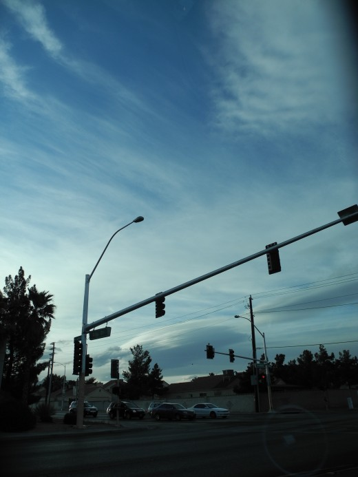 Huge areas of town engulfed with chemtrail lines that morph into huge expansive cloud formations.