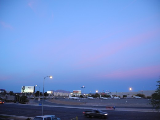 Gorgeous color theme, if this weren't so toxic to our lungs and health.  Pink stripes which have diffused into the blue skies, reflecting the recent chemical attack by chemtrail pilots earlier that afternoon... caught in a haze at McCarron Airport.