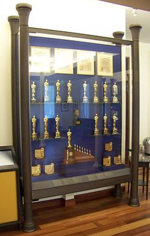 This display case in the lobby of the Walt Disney Family Museum in San Francisco shows many of the Academy Awards he won, including the distinctive special award at the bottom for Snow White and the Seven Dwarfs.