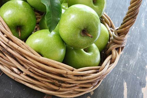Granny Smith Apples in a Cane Basket Image:  Robyn Mackenzie Shutterstock.com