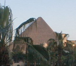 The Great Pyramid of Khufu (Cheops) seen from the grounds of a nearby hotel
