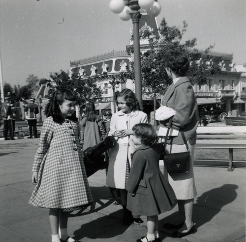 1957 - Back in the day, ladies felt compelled to wear skirts and dressy shoes, hair coiffed just so, for the special occasion of visiting Disneyland. Thankfully, this is one custom that has changed over the years. -- CC lic: http://bit.ly/wmgij