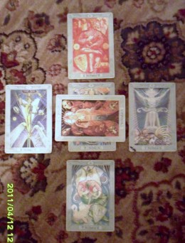 Central card represents my position in the question.  Horizontal card represents what may thwart me. Bottom card represents that which is beneath me, my foundation. Top card  that which is above me, to right -recent past, to left-the near future