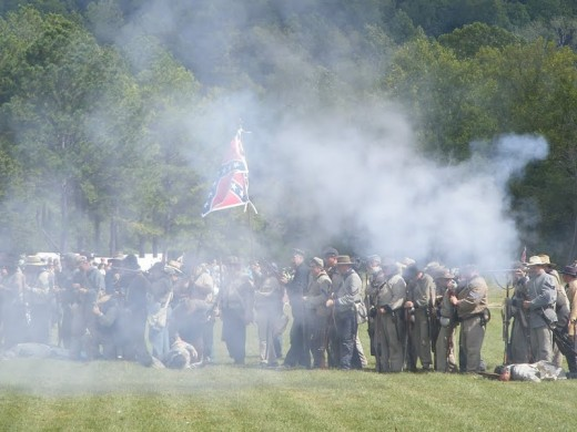 Confederate forces at the base of Pilot Knob firing on Fort Davidson