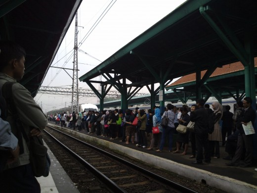 Commuting workers in Jakarta are waiting for the train.