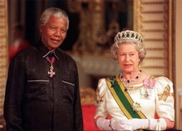 Mandela stands with The Queen on his arrival at Buckingham Palace, for a state banquet in his honour.
