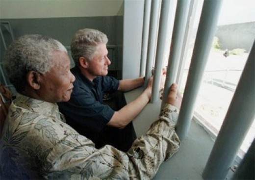 Mandela soon developed an international reputation as an uncompromising, no-nonsense president, as Bill Clinton found out during his visit to South Africa in 1999. Clinton was taken to Robben Island and, as this picture shows, he was taken into the c