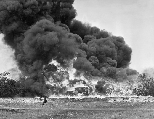 A demonstration of a flame fougasse somewhere in Britain. A car is surrounded in flames and a huge cloud of smoke circa. 1940