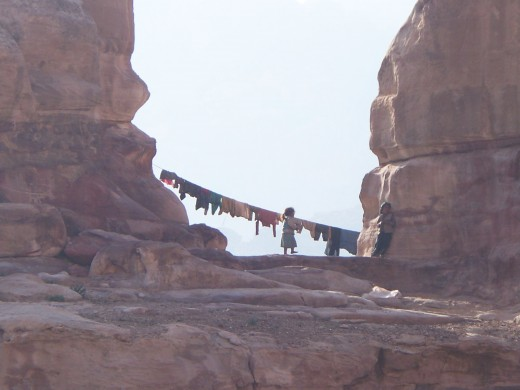 Bedouin children doing chores in Petra, Jordan