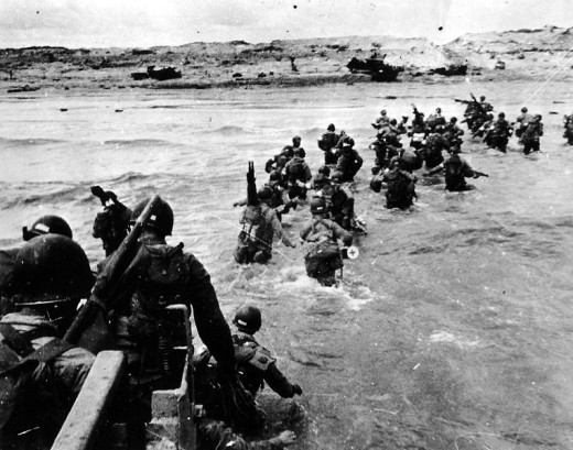 Soldiers landing on Utah Beach. Richard Winters led Easy Company to defeat the Germans firing Cannons at the soldiers landing by boat on Utah Beach.