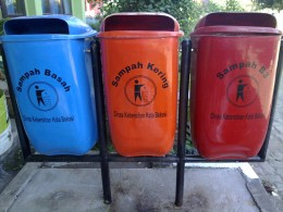Rubbish bins are painted in different colors to help people classify garbage they dump. It will also help the next process for recycling.