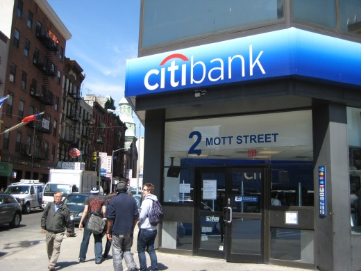 CitiBank on 2 Mott Street. This is a great place to meet. There are ATMs for cash too since many of the restaurants and souvenir shops do not accept credit cards.