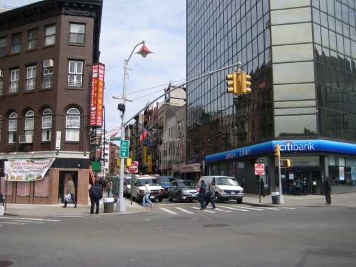 This is the intersection of Mott Street and Worth Street. Mott Street is a great place to start exploring NYC Chinatown.
