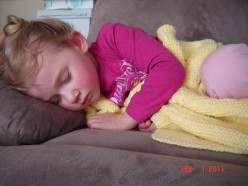 Ah--more like it--close up of cute baby sleeping.  No distractions.