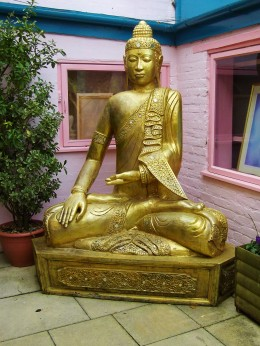 Golden Buddha statue outside a shop in Glastonbury.