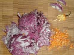 Chop the red onion and habanero pepper.