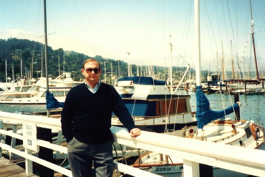 My hubby with the marina as backdrop - One of the marinas in Sausalito