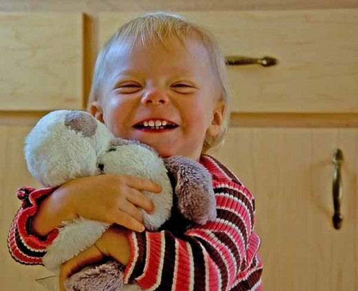 Toddler Girl With Stuffed Animal