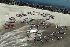 John Quigley forms aerial art to make political statements.
