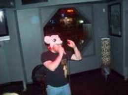 me, the author, performing Karaoke at the Ambassador in the Hollywood Neighborhood in Portland, Oregon