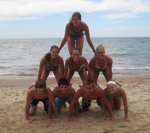 You head down the beach to soak up the last rays of the season when somebody suggests a human pyramid. What's the harm?