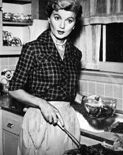 "June Cleaver--played by Barbara Billingsly as the ""Perfect 1950s Wife"" in Leave It To Beaver."