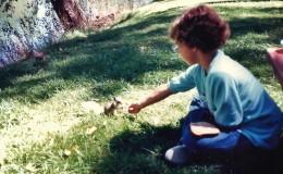My niece feeding a squirrel