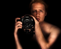 This facial expression works for me like a charm.  But this guy isn't dumb- in fact, anyone able to compose a well-lit self portrait like this is far from dumb, IMHO.