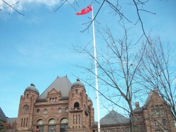 The Legislative Building of the Parliament of Ontario, with the Provincial flag of Ontario