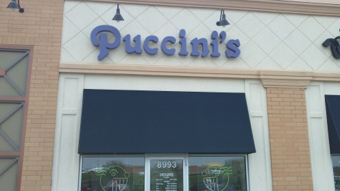 Puccini's with Chris Pyle-inspired neon in the front windows