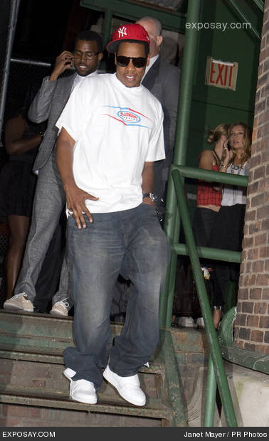Over sized tee, faded jeans, sneakers, ball cap and very dark sunglasses.