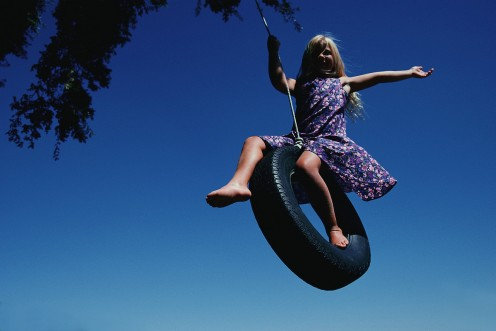 Clarissa on the tire swing.