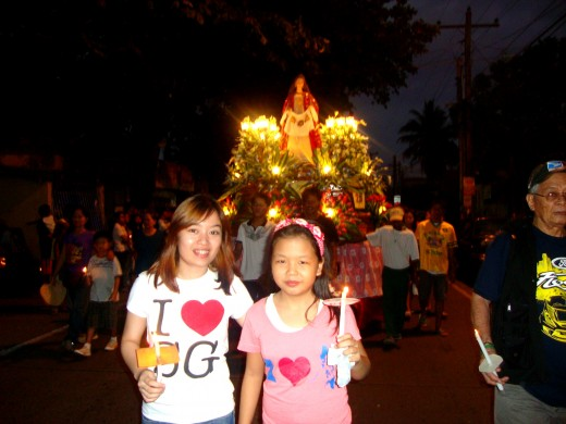 Yes, we walk about 3 kilometers with lighted candles with the Saints and Jesus' carriage...