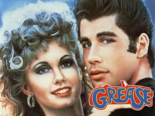 "John Travolta and Olivia Newton-John. http://www.youtube.com/watch?v=FpJUrt0O7uY ""Summer Nights"""