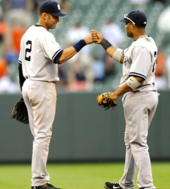Both middle infielders Derek Jeter (left) and Robinson Cano (right) celebrate the Yankees 6-3 win over the Baltimore Orioles.