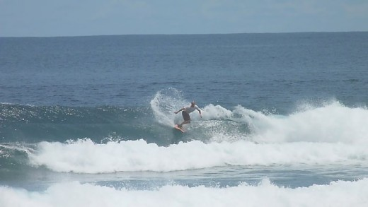 Victor was wave surfing at Amban beach. This photo was taken by Anne B..