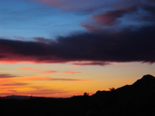 The dark cloud and the sunset in the San Bernardino Mountains.