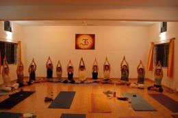 To be yoga teachers performing Padma Parvatasana in Shala Yoga Institute Mysore