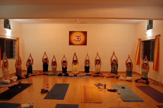 To be yoga teachers performing Padma Parvatasana in Shala Yoga Institute Mysore