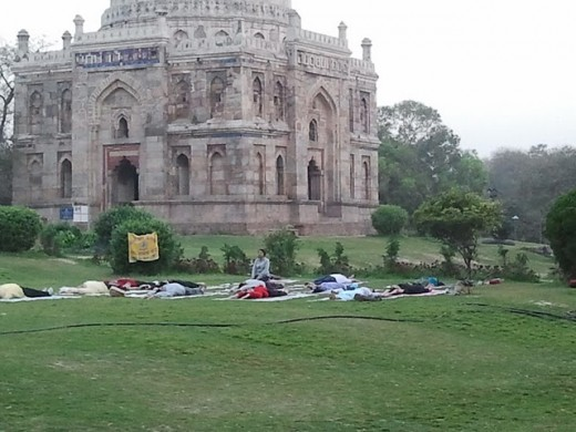 Several students learning yoga in the early morning hours at Lodhi Garden in New Delhi. According to me, learning Yoga in a garden or park is much better than learning inside the room. Might be possible as I am nature lover.