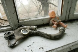 Gas mask with a doll
