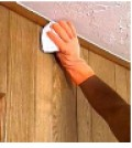 Prepping the wood paneling to use primer.