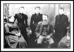 Seated from left: Caroline, Charles, Standing from left: Mary, Carrie, Laura.