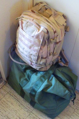 Duffel bags packed and waiting by the door is a sign the day of deployment is fast approaching.