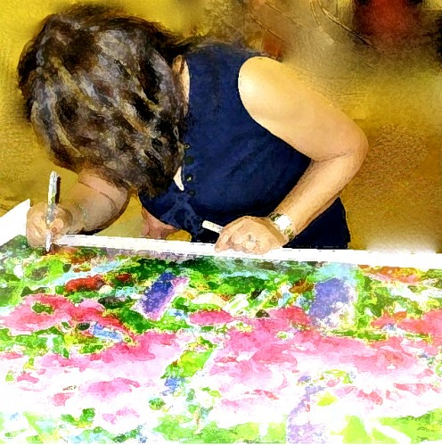 "Artist signing artwork ""Bougainvilleas"" on Giclee"