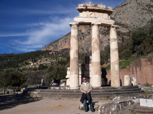 Andy at the tholos of the sanctuary of Athena at Delphi.