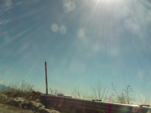 Sun rays shining down on Highway 18.