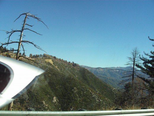 This car went by so fast it looks as if part of it is disappearing as it drives up the mountain.