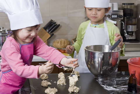 Young children cook