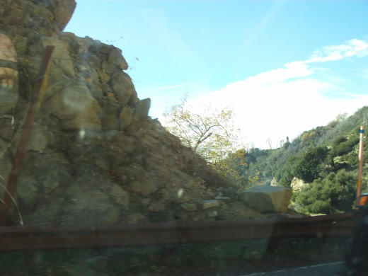 Rocks on the side of the road.  These can be a danger during storms that dislodge the rocks from the hillsides.